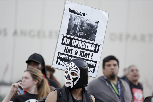 Demonstrators participate in a May Day rally in Los Angeles, California May 1, 2015. (Photo by Jonathan Alcorn/Reuters)