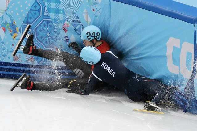 Sjinkie Knegt of Netherlands, back, and Park Se-Yeong of South Korea crash out in a men's 1500m short track speedskating final at the Iceberg Skating Palace during the 2014 Winter Olympics, Monday, February 10, 2014, in Sochi, Russia. (Photo by Ivan Sekretarev/AP Photo)