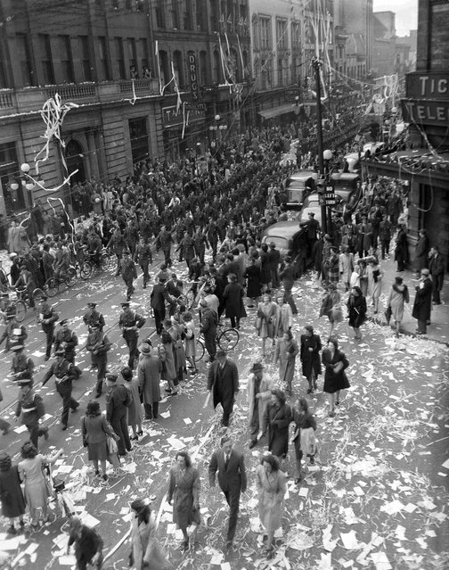 A crowd celebrates VE-Day in Ottawa, Ontario, May 8, 1945, in this handout photo provided by Library and Archives Canada. (Photo by Reuters/Canada Department of National Defence/Library and Archives Canada)