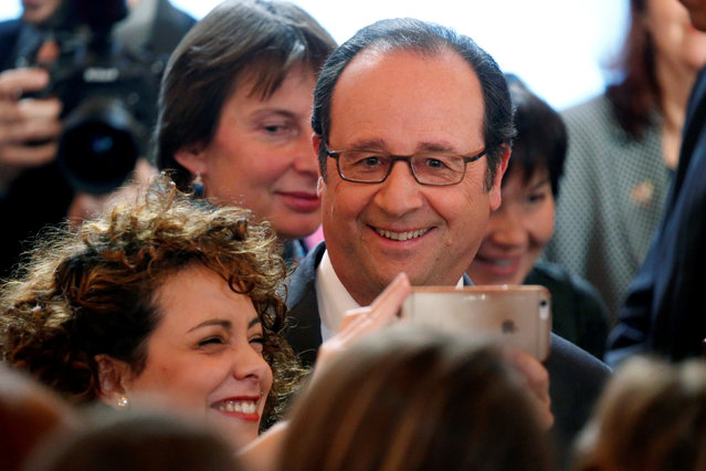 French President Francois Hollande poses for a selfie during a meeting on apprenticeship in public service in Paris, France, February 13, 2017. (Photo by Charles Platiau/Reuters)