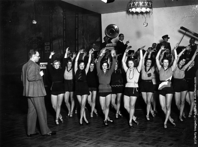 Mr. Andre Charlot rehearses his chorus for the cabaret section of the Grand Ball at the Royal Opera House