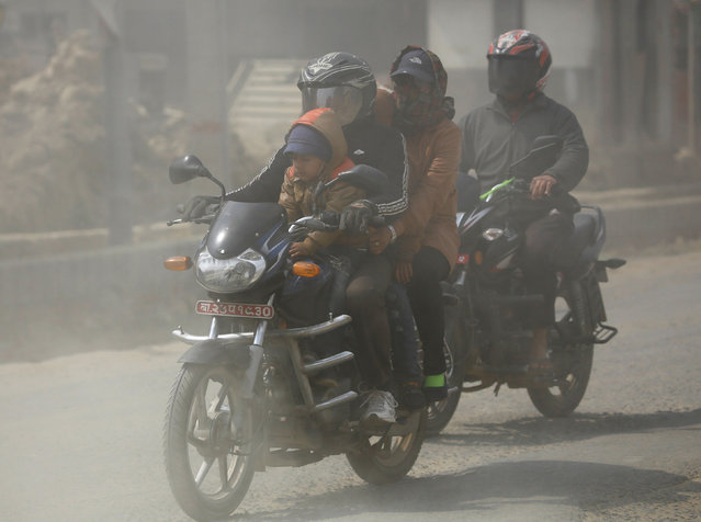A family travels on a motorcycle along a dusty road in Kathmandu, Nepal February 27, 2017. (Photo by Navesh Chitrakar/Reuters)