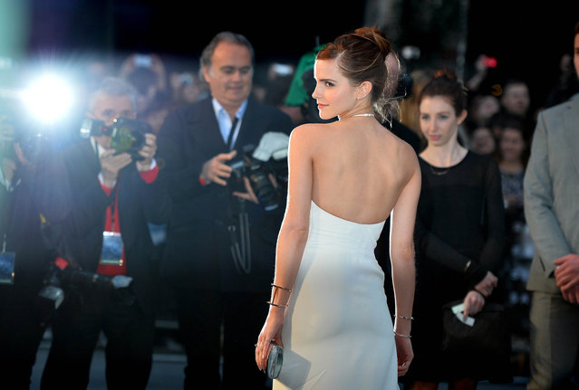 "British actress Emma Watson poses for pictures on the red carpet as she arrive for the UK premiere of her latest film ""Noah"" in Leicester Square, central London, on March 31, 2014. (Photo by Ben Stansall/AFP Photo)"