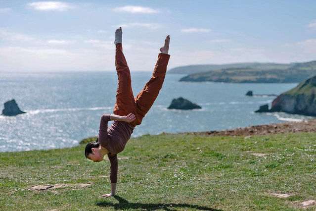 Shaw En Chew, a Singaporean dancer, joins a cast from Torbay in Silence Between Waves, a dance performance with Berry Head as its backdrop in England on April 17, 2019. (Photo by Jim Wileman/The Times)