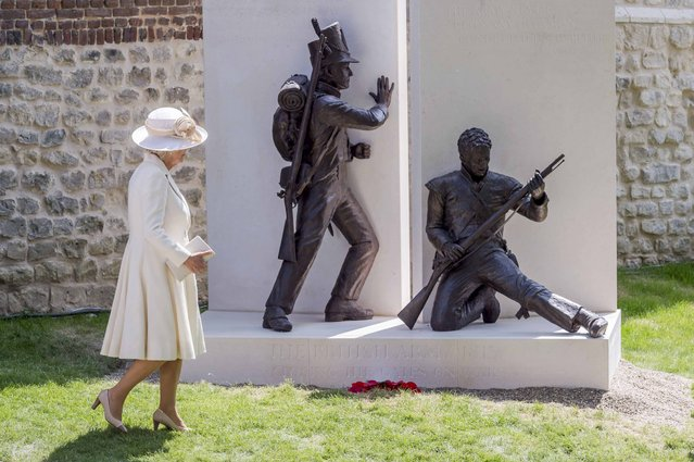 Britain's Camilla, the Duchess of Cornwall, walks by a newly-unveiled monument during a ceremony for the opening of the Hougoumont farm as part of the bicentennial celebrations for the Battle of Waterloo, near Waterloo, Belgium June 17, 2015. The commemorations for the 200th anniversary of the Battle of Waterloo will take place in Belgium on June 19 and 20. REUTERS/Geert Vanden Wijngaert/Pool