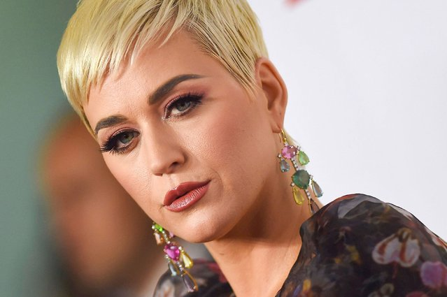 "In this file photo taken on February 08, 2019 US singer Katy Perry arrives for the 2019 MusiCares Person Of The Year gala at the Los Angeles Convention Center in Los Angeles. US singer Katy Perry plagiarized the beat of her 2013 hit ""Dark Horse"" from a Christian rap song, a Los Angeles jury found Monday July 29, 2019. (Photo by Valerie Macon/AFP Photo)"