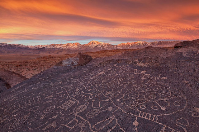 "A beautiful sunrise forms over an amazing set of ancient petroglyphs facing the heavens with the Eastern Sierras in the backdrop. ""I have always been fascinated seeing ancient ruins and artwork that tell a story of America's past"", says Huang. Eastern Sierras, California. (Photo by Willie Huang/Smithsonian.com)"