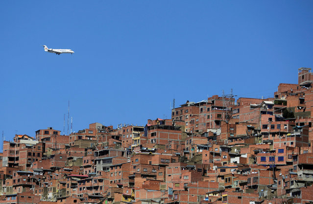 A plane is seen from Chua Uma, a neighbourhood that changed thanks to urban art, in La Paz, Bolivia on June 27, 2019. (Photo by David Mercado/Reuters)