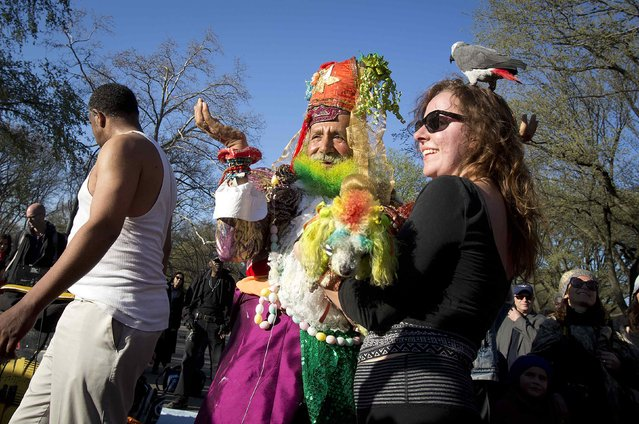 People take part in a 420 dance party, an event celebrating marijuana culture, at Central Park in New York April 20, 2014. (Photo by Carlo Allegri/Reuters)