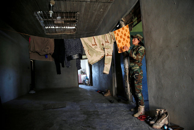 Yazidi female fighter Asema Dahir, 21, hangs laundry to dry at a site near the frontline of the fight against Islamic State militants in Nawaran near Mosul, Iraq, April 20, 2016. (Photo by Ahmed Jadallah/Reuters)