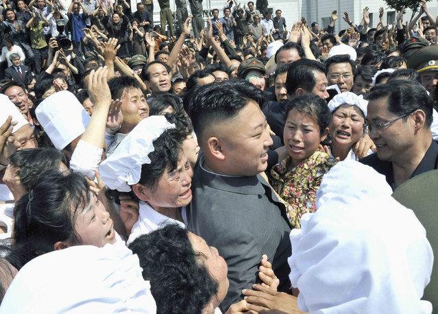 North Korean leader Kim Jong-un (C) visits Pyongyang Essential Foodstuff Factory in this undated photo released by North Korea's Korean Central News Agency (KCNA) in Pyongyang June 8, 2013. (Photo by Reuters/KCNA)