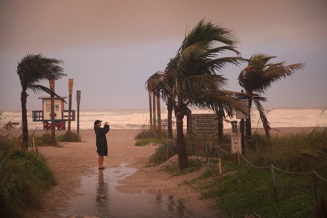 A woman takes a picture as the effects of Hurricane Dorian begin to be felt on September 2, 2019 in Cocoa Beach, Fla. (Photo by Scott Olson/Getty Images)