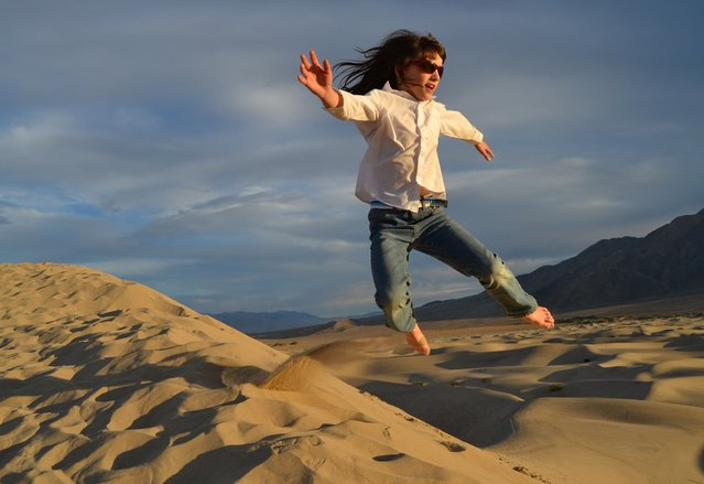 Winner of the National Park Foundation's photo contest; Honorable Mention: Let's Move! Death Valley National Park, California. Girl jumping over the sand dunes near Stovepipe Wells. (Photo by Linnea Charnholm)