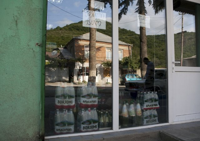 Bottles of Borjomi bottled mineral water (R, L) are seen at a shop in Leningori (or Akhalgori), in the breakaway region of South Ossetia, Georgia, July 6, 2015. (Photo by Kazbek Basaev/Reuters)