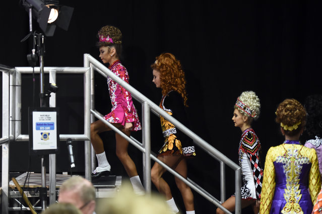 Solo dancers queue up to perform on stage during the World Irish Dancing Championships in Dublin, Ireland on April 11, 2017. (Photo by Clodagh Kilcoyne/Reuters)