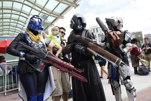 Guests dressed in costume attend day 1 of Comic-Con International on Thursday, July 9, 2015, in San Diego, Calif. (Photo by Chris Pizzello/Invision/AP Photo)