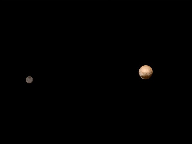 Pluto (R) and its moon Charon are pictured from about 6 million kilometers in this July 8, 2015 NASA handout photo from the New Horizons' Long Range Reconnaissance Imager (LORRI). New Horizons is expected to come as close as 12,500 km from Pluto at 7:49 a.m. EDT/11:49 GMT on July 14, 2015. (Photo by Reuters/NASA-JHUAPL-SWRI)