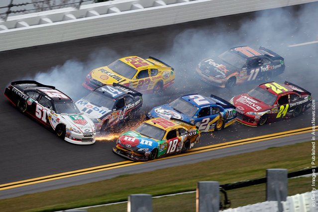 Kurt Busch, driver of the #51 Tag Heuer Avant-Garde Chevrolet Chevrolet, spins out causing Tony Stewart, driver of the #14 Office Depot/Mobil 1 Chevrolet, and part of the field to pile up during practice for the NASCAR Budweiser Shootout at Daytona International Speedway