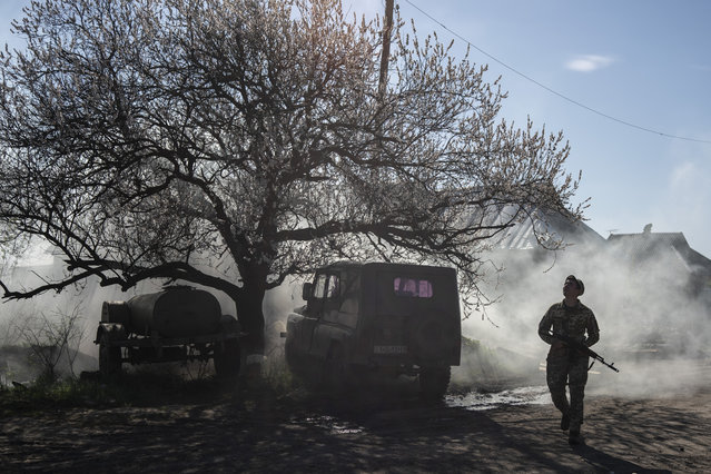 A Ukrainian serviceman guards a position near the front line as the conflict continues, in Mariinka, Donetsk region, eastern Ukraine, Saturday, April 20, 2019. The two presidential candidates for election on Sunday are pressing separate solutions for a resolution of the conflict in eastern Ukraine, where fighting with Russia-backed separatist rebels has killed more than 13,000 people since 2014. (Photo by Evgeniy Maloletka/AP Photo)