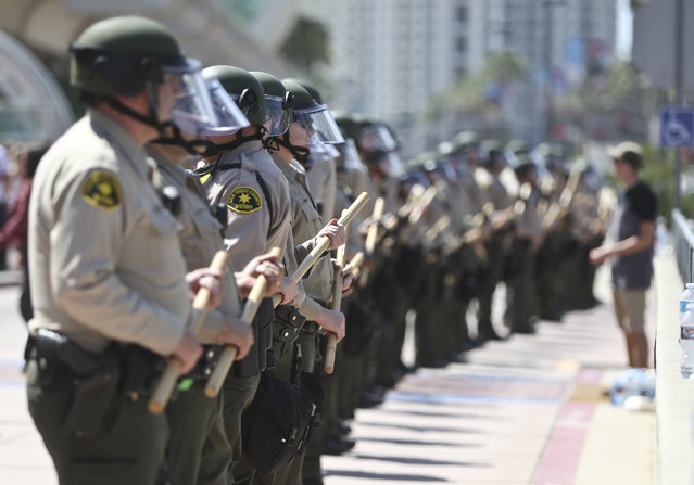 The San Diego County Sheriff department stands ready to react out front of the San Diego Convention Center where Donald Trump spoke Friday, May 27, 2016, in San Diego. (Photo by Lenny Ignelzi/AP Photo)