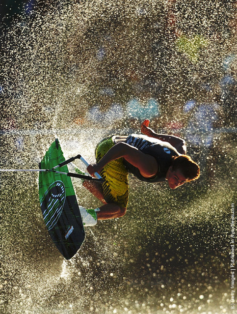 A competitor in action during the Mens Wakeboard event in the Moomba Masters Water Ski International Invitational Championships during the Moomba Festival