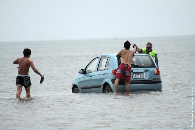Three Japanese tourists had to abandon plans to drive to Stradbroke Island off the Queensland coast when their hire car became bogged in mangrove mud, on March 15, 2012 near Stradbroke Island, Australia