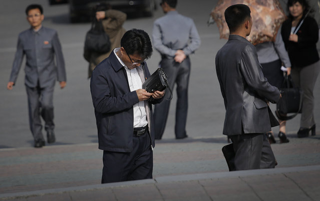 In this Tuesday, May 5, 2015, photo, a man uses his smartphone in Pyongyang, North Korea. North Korean officials have unveiled a mobile-friendly online shopping site. (Photo by Wong Maye-E/AP Photo)