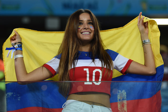 A fan holds a Colombian flag before a Group G football match between Ghana and US at the Dunas Arena in Natal during the 2014 FIFA World Cup on June 16, 2014. (Photo by Carl De Souza/AFP Photo)
