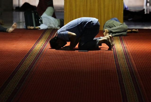 A Muslim man prays on the first day of the holy fasting month of Ramadan at Istiqlal Mosque in Jakarta, Indonesia, Monday, June 6, 2016. (Photo by Tatan Syuflana/AP Photo)