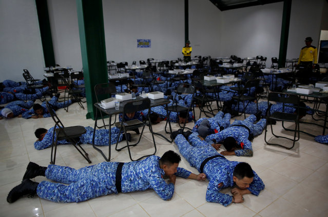"Participant of the Bela Negara – ""defend the nation"" – programme are forced onto the floor by military trainers while eating breakfast at a training centre in Rumpin, Bogor, West Java, Indonesia June 2, 2016. (Photo by Darren Whiteside/Reuters)"