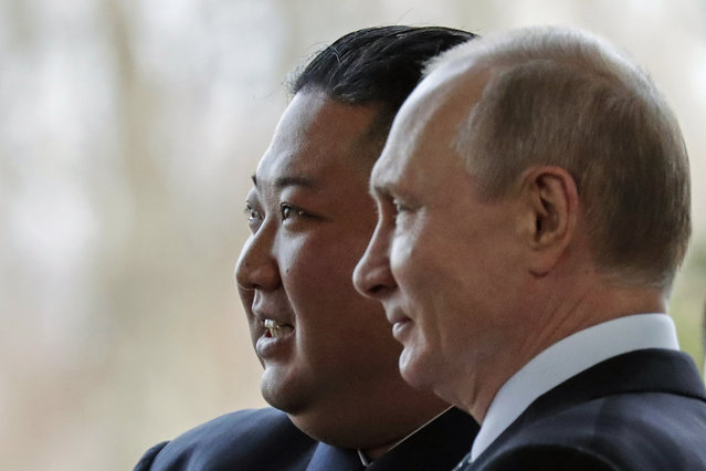 Russian President Vladimir Putin, right, and North Korea's leader Kim Jong Un pose for photographers during their meeting in Vladivostok, Russia, Thursday, April 25, 2019. Putin and Kim are set to have one-on-one meeting at the Far Eastern State University on the Russky Island across a bridge from Vladivostok. The meeting will be followed by broader talks involving officials from both sides. (Photo by Alexander Zemlianichenko/AP Photo/Pool)