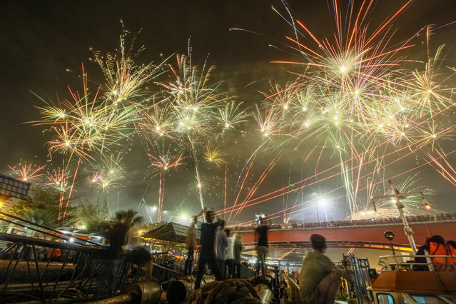 Fireworks illuminate the Ampera Bridge during a New Year's Eve celebrations in Palembang, Indonesia on January 1, 2020. (Photo by Muhammad Tohir/Sijori Images via ZUMA Wire/Rex Features/Shutterstoc)