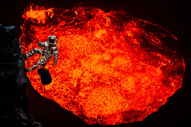 Adventurer Sam Cossman movies towards the huge lava lake wearing a custom built industrial proximity heat suit on December 20, 2014 in Ambrym, Vanuatu. (Photo by Conor Toumarkine/Barcroft Media)