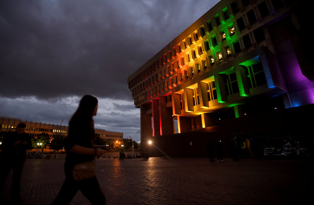 Boston's City Hall is lit in the colors of the pride flag for the victims of the mass shooting at Orlando's Pulse nightclub, in Boston, Massachusetts, U.S. June 13, 2016. (Photo by Gretchen Ertl/Reuters)
