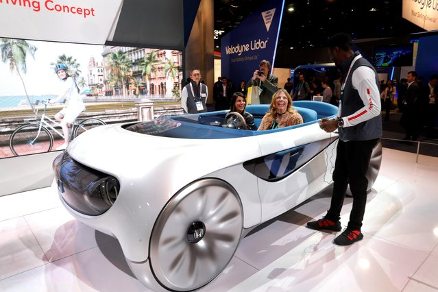 Attendees try out new automotive technology in a Honda augmented driving concept vehicle during the 2020 CES in Las Vegas, Nevada, U.S. January 7, 2020. (Photo by Steve Marcus/Reuters)