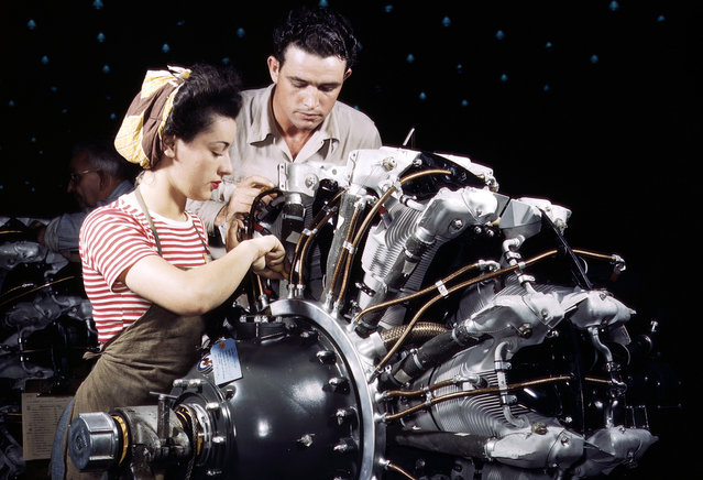 Women are trained as engine mechanics in thorough Douglas training methods, at the Douglas Aircraft Company in Long Beach, California, in October of 1942