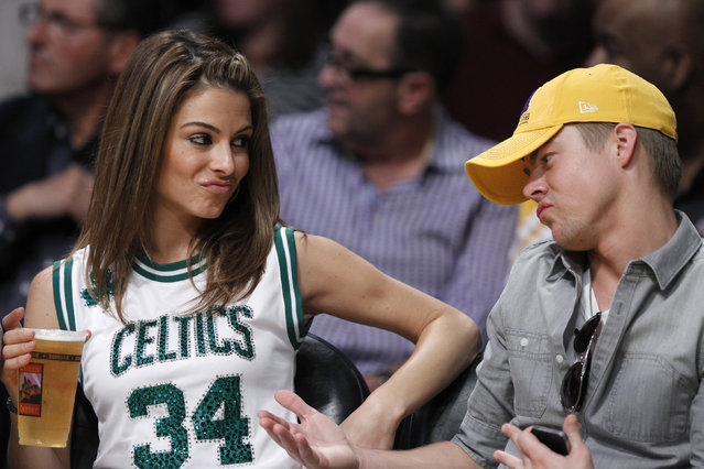 Maria Menounos and Derek Hough sit courtside as the  Celtics play the Lakers in Los Angeles, March 2012. (Photo by Lucy Nicholson/Reuters)