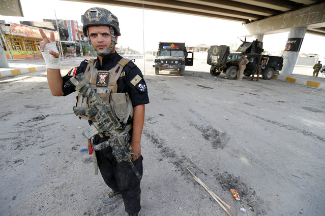 A member of Iraqi counterterrorism forces gestures in Falluja, Iraq, June 26, 2016. (Photo by Thaier Al-Sudani/Reuters)