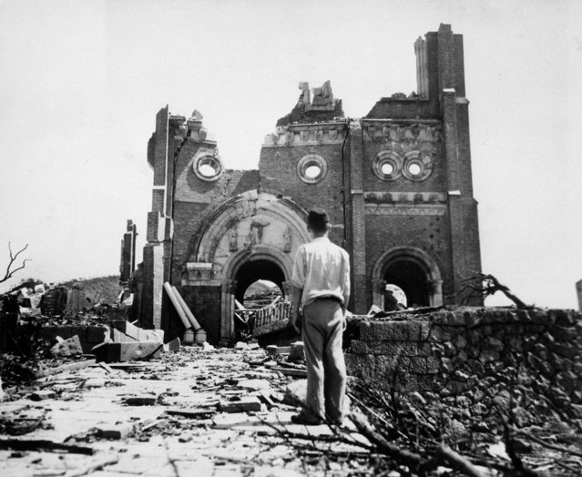 The Urakami Catholic Cathedral in Nagasaki, seen Sept. 13, 1945, is laid waste in the aftermath of the detonation of the atom bomb over a month ago over this city. (Photo by Stanley Troutman/AP Photo/ACME)