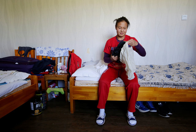 Mongolia's wrestler Cantuya Enkhbat prepares for a daily training session at the dormitory of the Mongolia Women's National Wrestling Team training centre in Bayanzurkh district of Ulaanbaatar, Mongolia, July 1, 2016. (Photo by Jason Lee/Reuters)