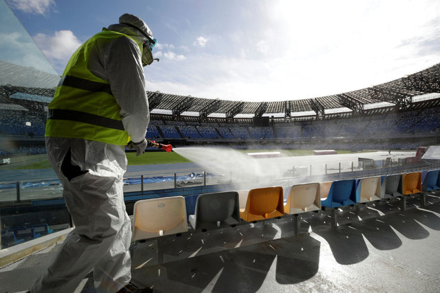 A cleaner wearing a protective suit sanitises seats at the San Paolo stadium ahead of the second leg of the Coppa Italia semi-final between Napoli and Inter Milan, which has since been postponed as part of measures to contain the coronavirus outbreak, in Naples, Italy, March 4, 2020. (Photo by Ciro De Luca/Reuters)