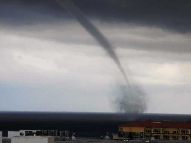 "First Place, Landscapes And Scenics. ""Waterspout Over Lake Worth"". (Photo by Iris Fahrer/The Palm Beach Post)"