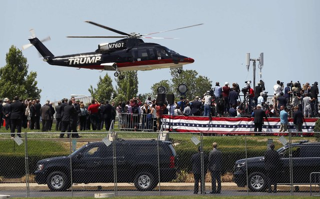 The helicopter carrying Republican U.S. presidential nominee Donald Trump lands before an event in Cleveland, Ohio, U.S. July 20, 2016. (Photo by Lucas Jackson/Reuters)