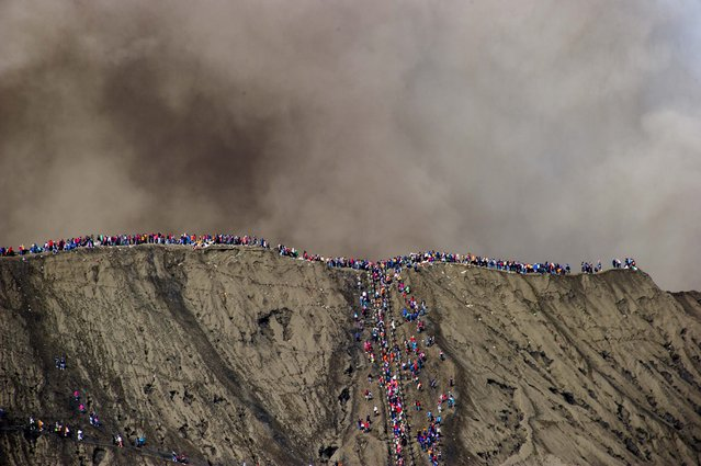 A general view of worshippers gathering at the crater of Mount Bromo during the Yadnya Kasada Festival in Probolinggo, East Java, Indonesia, 21 July 2016. (Photo by Fully Handoko/EPA)