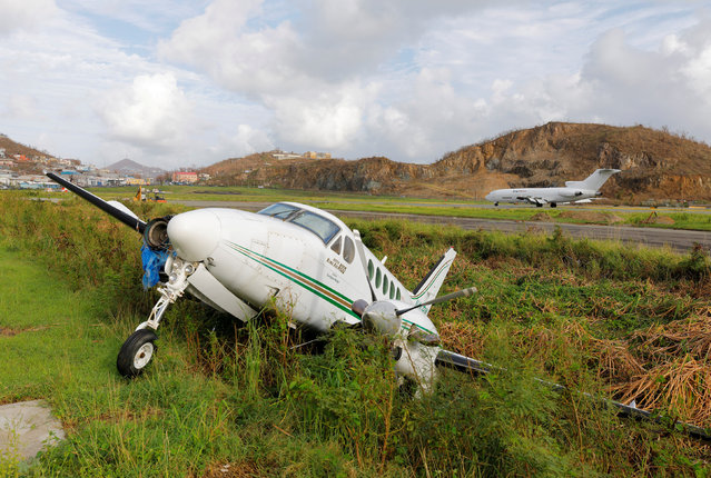 A private plane damaged by Hurricane Irma lies in a ditch at Cyril E. King Airport more than a week after the cyclone pounded the Caribbean, in Charlotte Amalie, St. Thomas, U.S. Virgin Islands September 15, 2017. (Photo by Jonathan Drake/Reuters)
