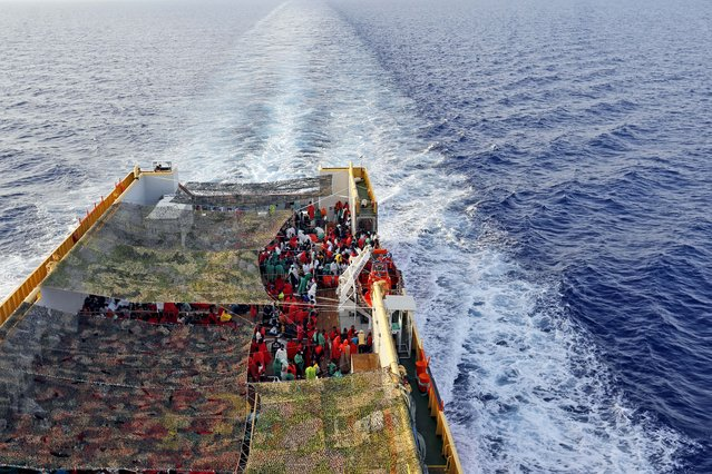 Migrants crowd the bridge of the Norwegian Siem Pilot ship sailing along the Mediterranean sea, Wednesday, September 2, 2015. The Siem Pilot is carrying to the Italian Port of Cagliari hundreds of migrants rescued in several operations in the Mediterranean sea. (Photo by Gregorio Borgia/AP Photo)