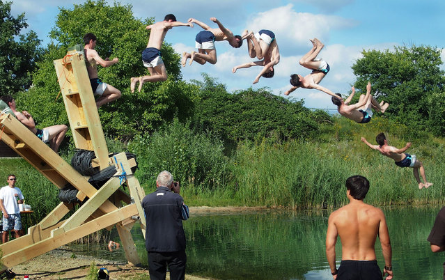 Two brothers have built a human catapult to fly into a lake. Johannes Schrieber, 26, and his brother Daniel, 28, from Frankfurt, Germany built the wooden contraption, which can fire people five metres into the sky and 12 metres away. The brothers raised more than £700 through crowdfunding to buy the materials, with every penny well spent as nobody has died yet! (Photo by Caters News)