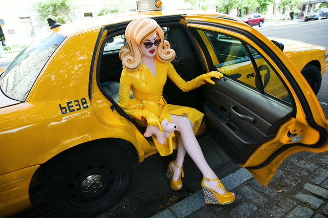 «Pandemonia, New York Taxi». Pandemonia's anonymous creator describes her as a 'critical reflection and intervention upon ideas of celebrity and femininity'. By staging Pandemonia, with all her plastic attributes, in everyday settings, the artist riffs on the commodification of femininity in contemporary culture. (Photo by Simon Cave/The Guardian)