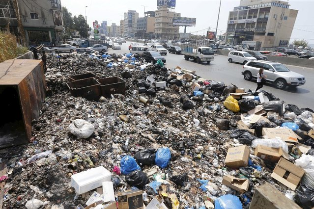 Garbage is piled along a highway in Beirut, Lebanon, September 3, 2015. Lebanon has been hit by a series of protests over a trash crisis that has led to piles of refuse building up in the streets in recent weeks, as well as anger about political paralysis. (Photo by Mohamed Azakir/Reuters)