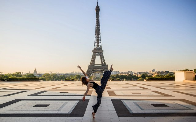 Syrian dancer and choreographer Yara al-Hasbani performs a dance on the empty Trocadero square in front of the Eiffel tower in Paris on April 22, 2020, on the 37th day of a strict lockdown in France to stop the spread of COVID-19 (novel coronavirus). (Photo by Sameer Al-Doumy/AFP Photo)